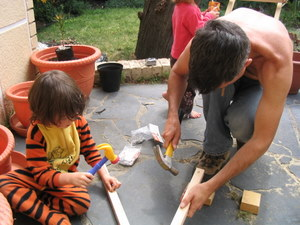Tigger helping with hammering